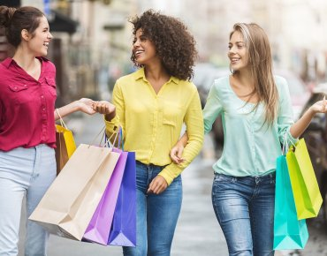 Women shopping for fashionable items
