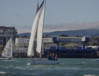 Photo of a boat sailing around Dun Laoghaire harbour
